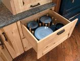 Store Your Dishes in A Base Cabinet Drawer