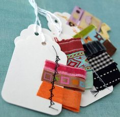 Sew Cute Tags - really cute idea to stich fabric folds into the arabic journal in order to mark sections LOVE IT - use ribbons