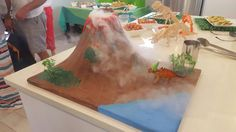 Dinosaur party - paper mache volcano with dry ice - kids loved it