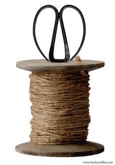 Linen roll with antique wood stand & scissors