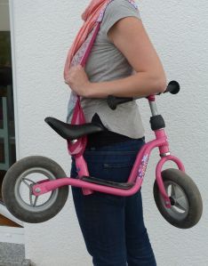 When the kids don't want to ride there bike back to the house simply tie a scarf or Baby wrap around it and wear it on the side like a purse
