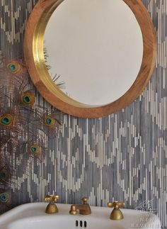 the mosaic wall is hot, but i'm in love with the leafing on the inner rim of the mirror- tres chic.