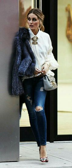 Olivia Palermo. Ripped denim, blue fur, white blouse and statement necklace