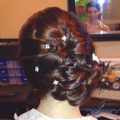 Bridal side swept updo.  Sophisticated and clean but still very interesting and intricate.  Twist in bling for the final touch.