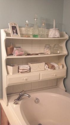 Buffet hutch top for bathroom storage.. love this!  I would use an outdoor spray paint and secure it to the wall but what a great idea.
