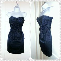 "Navy Blue Satin Bebe Dress Navy blue, satin, ruffle accents that line front bust & back. Wear strapless or with adjustable spagetti straps.  Worn once!  Wish I still fit in it!  :(  ? Max of 48 hr hold ? 15% off discounts on bundles of 3 items or more!  ? NO SWAPS/TRADES ? Will ship next business day after purchase, EXCEPT on Sundays. ? Please ask any ???'s or for more pics.  ? Offers will only be considered when using ""Make Offer""! bebe Dresses Strapless"