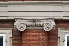 kapiteel - h5 - hoofdje van een zuil/pilaster