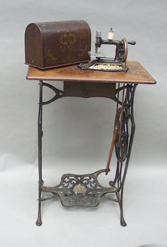 I believe this may be a Toy Treadle! If it is, it's as rare as hen's teeth. Treadle Sewing Machines, Antique Sewing Machines, Sewing Machine Drawing, Sewing Machine Accessories, Vintage Sewing Notions, Repurposed Items, Sewing Table, Sewing Rooms, Vintage Crafts