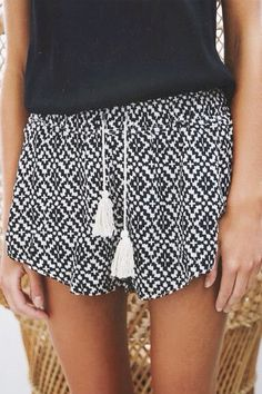 Patterned shorts and a tank top. The perfect combo.