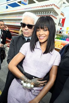 Rihanna at Chanel The only thing more epic than the Chanel fall 2014 runway show supermarket set was probably this exact moment: Rihanna and Karl Lagerfeld holding each other. RiRi's girly beauty vibe is a nice pause from the over-the-top drama we usually see her in, too.