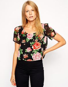 T-shirt by Love Made from a woven poly fabric Round neckline Semi-sheer finish Floral print Cropped cut Regular fit