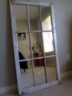 rustic shabby chic mirror barn window. I would hang it on the wall though.
