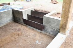 Concrete retaining wall and corten steel risers