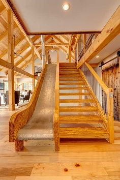 Industrial slide in barn home timber frame home by Davis Frame Company