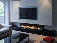 46 Elegant Modern Chimney Ideas - A fireplace is a beautiful decorative option, and one of the most preferred, too, for most Americans when they buy a home. Living Room Tv, Living Room With Fireplace, Living Room Modern, Living Room Designs, Fireplace Tv Wall, Modern Fireplace, Fireplace Design, Tv Wall Design, House Design