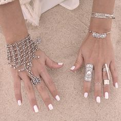 White nails and gorgeous rings