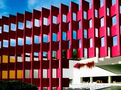 """The Camino Real, which is also located in Polanco, bills itself as a """"Hotel-Museum."""" Designed by Mexico City native Ricardo Legorreta in 1968, the Teōtīhuacān-style pyramid shares space with bright pink and yellow geometric patterns. It was made as an homage to both modern and ancient Mexico."""