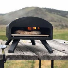 You need outdoor pizza ovens that use high-quality materials in its construction. They offer a smoky taste of an oven-baked pizza without any compromise. Outdoor Gas Pizza Oven, Home Pizza Oven, Portable Pizza Oven, Brick Oven Pizza, Outdoor Kitchen Bars, Outdoor Cooking, Backyard Kitchen, Outdoor Kitchens, Outdoor Rooms