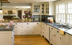 Not a huge fan of white cabinets, but this is really pretty--especially with this beautiful wood floor