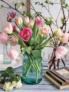 pink tulips in a blue glass vase