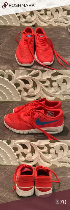 Nike Eric koston 2 signature model red These are designed as a skate shoe. But have a similar air max vibe to them. They are bright red with blue swoosh. Men's 7 or wmns 8.5 Nike Shoes Athletic Shoes