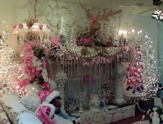 Penny's Vintage Home - Pink Christmas mantel - like the curtain covering the fireplace opening, when it's not burning.  Lots of decorations around the mantel!
