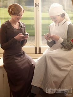 Behind the scenes at Downton (18 pics from EW)  How funny to see them dress in the period of the show and texting!!!  Love IT!