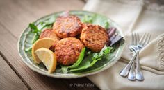 """These salmon cakes are perfect for a party, or just to spice up your weekly meals with something that may seem a bit more """"fancy."""" We topped ours with a squeeze of lemon juice, and a dollop of paleo mayo, but they are delicious on their own as well!"""
