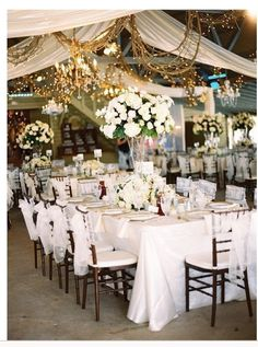 The elegance of white with the addition of grapevines & lights.  Behind head table or as a backdrop for indoor ceremony. - MV