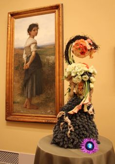 "Art Alive 2014 San Diego Museum of Art, Painting by William-Adolphe Bouguereau, ""The Young Shepherdess"" Floral Art by Jolene De Hoog Harris,The Dutch Flower, Fallbrook,CA"