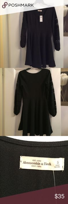 Black Abercrombie Dress w/ Long Sleeves I love this dress from Abercrombie, but unfortunately it didn't really fit me. It has stunning lace detailing on the sleeves and a V-neck neckline! This dress would be perfect for a party in the fall or winter. Never worn except to try it on. Abercrombie & Fitch Dresses Long Sleeve