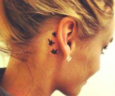 Behind the ear bird tattoo