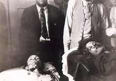 The bodies of Bonnie and Clyde shortly after they were removed from the death car and taken into the funeral home.