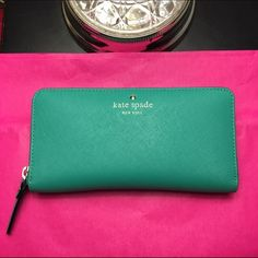 EUC Kate Spade Lacey Wallet ♠️ This Kate Spade wallet was purchased for $178. It has only been used once or twice and the only flaw to this is the embossing (as seen in photos) however, this happens over time and is natural. Color: dusty emerald. Reasonable offers only, posh only. Needs to go ASAP. Basically brand new! Tags in wallet. kate spade Bags Wallets