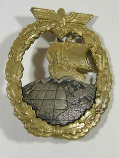 Kriegsmarine Auxiliary Cruiser badge by C.E. Juncker. This badge features a Viking ship with a warrior on the prow. The badge retains much of its original gilt finish.