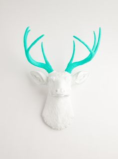 Faux Taxidermied - The Oleg - White W/ Turquoise Antlers Resin Deer Head- Stag Resin White Faux Taxidermy. $109.99, via Etsy.