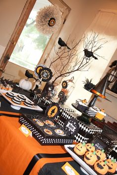 Look at this fabulous harlequin party table!  But, wait, what's with the witch silhouette???