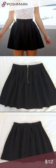 "Kaitlyn black skater skirt w/ zippered back small Kaitlyn black skater skirt. Size small. Zippered back with elastic waist for comfort. Easy to wear and soft material. Approximately 15"" in length. Kaitlyn Skirts Mini"