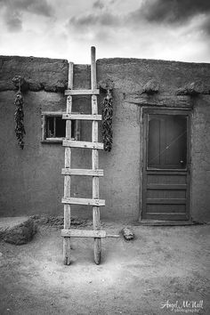 A black and white photo from Taos, New Mexico. This old adobe home, with a traditional ladder and chili pepper ristras, is a quintessential New Mexico scene. I love this image because it takes me right back to the beautiful land around Santa Fe and Taos, every time I look at it. This Black and white print will be made to order for you at a professional photo lab on fine art pearl paper, using archival inks. It will be coated with a lustre finish to protect it from fingerprints and fading. If…