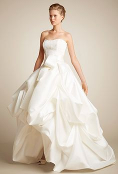 Brides: Giuseppe Papini. Short front long back wedding dress. Romantic silk skirt with a beaded sweetheart bodice in pure silk, satin belt.