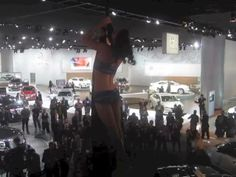 MUST WATCH! World renowned silk aerialist, Marina Luna, performing above VIA Motors booth at the LARGEST AUTO SHOW IN THE US - the North American International Auto Show before VIA's press conference. You can see VIA's 100mpg, extended-rang...