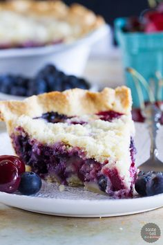 Hit up the farmer's market for fresh cherries and blueberries and turn them into this Cherry and Blueberry Cream Pie! Fresh berries are combined with a creamy sour cream filling and topped with plenty of streusel for a perfect summer pie.: