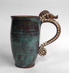 Seahorse Mug- Rustic Red Clay with Blue and White Latte. $53.00, via Etsy.