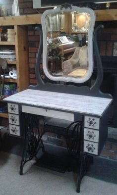 Repurposed Singer Sewing Machine Into a Beautiful Vanity.  I would paint it a different color...