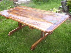 a barn beam table I just finished with turquoise and lapis inlays and a peony carving in the center