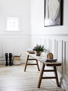 Paneled hallway featuring Hunter Gumboots, bench seat and Bloom & Co accessories.