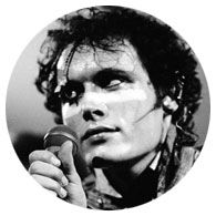 This photo was taken on the 'Kings of the Wild Frontier' tour. Just as Adam Ant pauses an unusual but interesting lighting effect came on, creating a vintage Hollywood look to the picture.