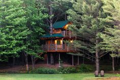 A cabin meets lodge meets New England treehouse at this bed and breakfast in Waterbury, Vermont, featuring rustic antique decor, circular staircases, wrap-around deck, and meadow views.