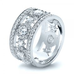 This dazzling women's anniversary band features round brilliant cut diamonds surrounded by bright cut set diamond halos, with additional prong and. Anniversary Bands For Her, Diamond Anniversary Bands, Anniversary Jewelry, Diamond Bands, Diamond Wedding Bands, Halo Diamond, Diamond Jewelry, Wedding Anniversary, Ring Ring