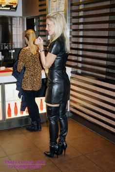 Sexy blonde in black leather dress and  Fernando Berlin thigh boots